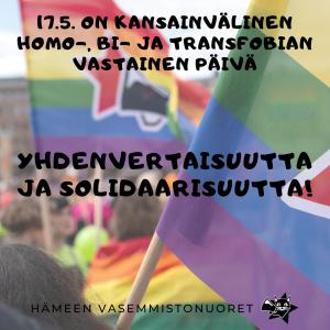 """Taustalla sateenkaarilippuja, etualalla teksti idahot-päivästä ja teksti """"Yhdenvertaisuutta ja solidaarisuutta!"""""""